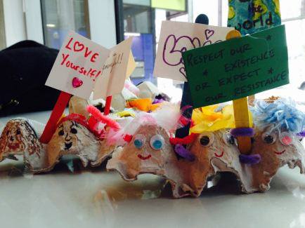 Egg Cartons decorated as people; Popsicle sticks and paper decorated as mini protest signs. Photo by Lindsay Fleming.